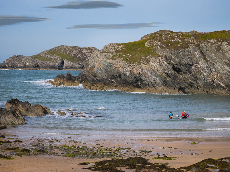 Porth Dafarch Beach with a small party of Coasteeriers heading out