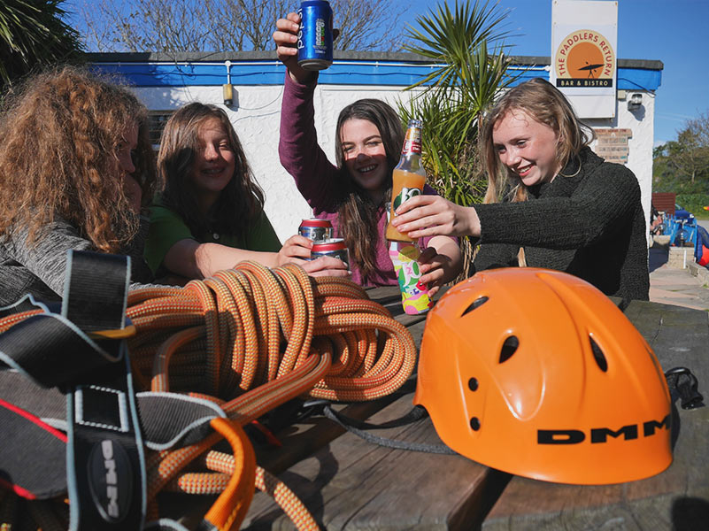 4 girls enjoy refreshments a The Paddlers Retun Bar