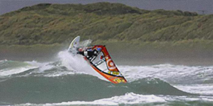 Man on a Windsurf in a rought sea on Anglesey