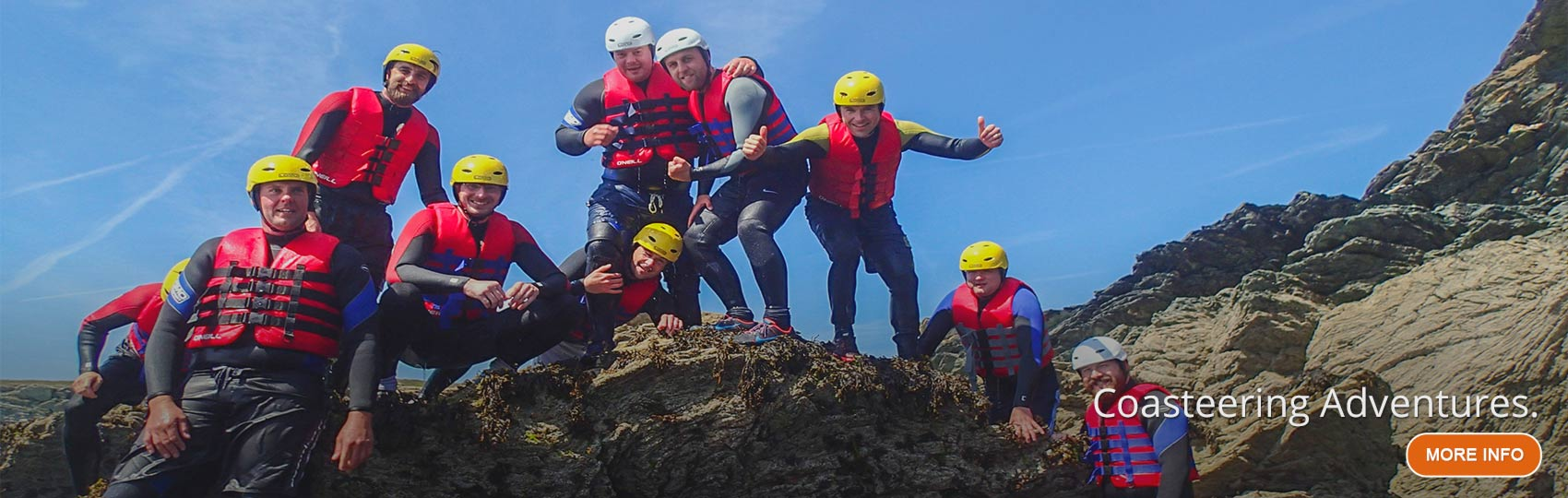 Jumping into the sea on a coasteering and rock climbing excursion